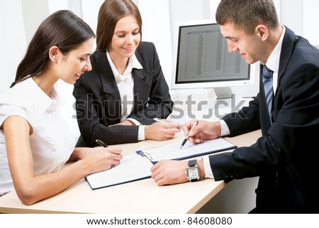 Happy business people working at the office - stock photo