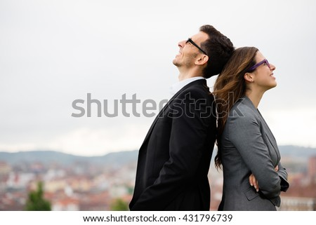 Happy business people. Young modern successful entrepreneurs outside. Teamwork success concept. - stock photo