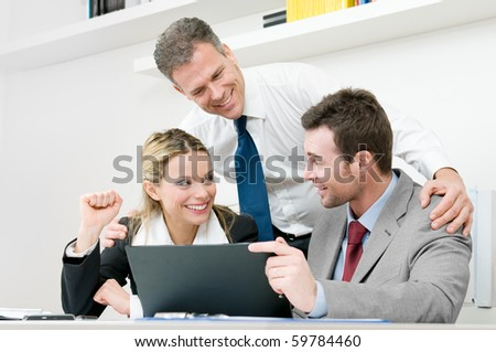 Happy business team celebrate and working together during a meeting in office - stock photo