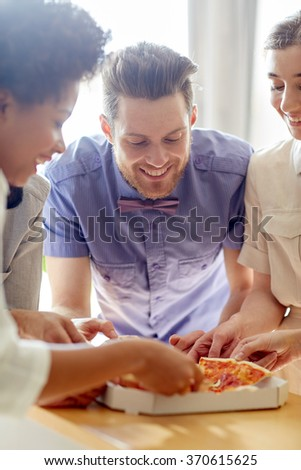 happy business team eating pizza in office - stock photo
