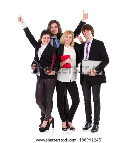Happy business team. Four young elegance smiling people. Full length studio shot isolated on white.
