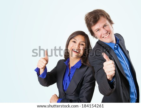 Happy Business team giving thumbs up, isolated on light blue background