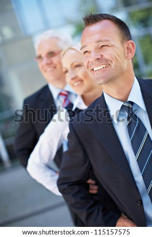 Happy business team group standing in a row - stock photo
