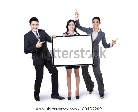 Happy business team holding empty billboard isolated on white background  - stock photo