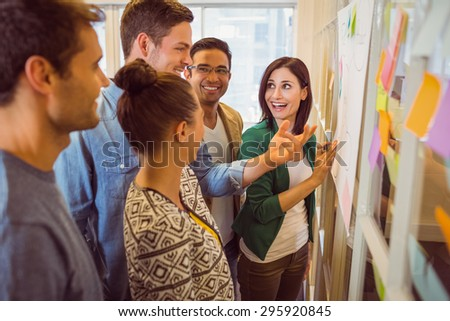 Happy business team in a meeting at office - stock photo