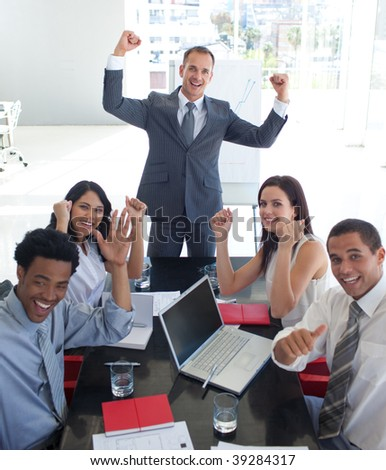 Happy business team in a meeting celebrating a success - stock photo