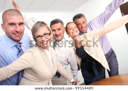 happy business team in office - stock photo