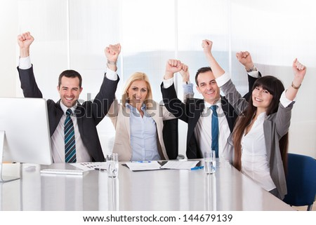 Happy Business Team In Office Celebrating Success - stock photo