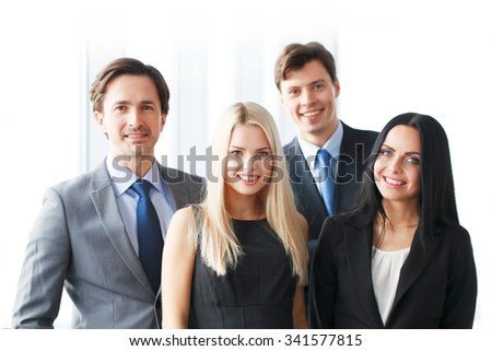 Happy business team of coworkers in office
