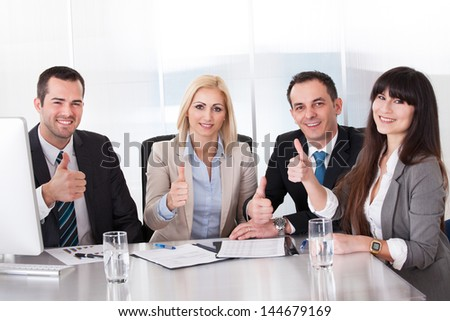 Happy Business Team Showing Thumb Up Sign