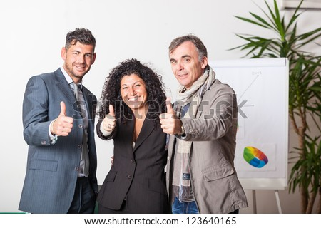 Happy Business Team with Thums Up - stock photo