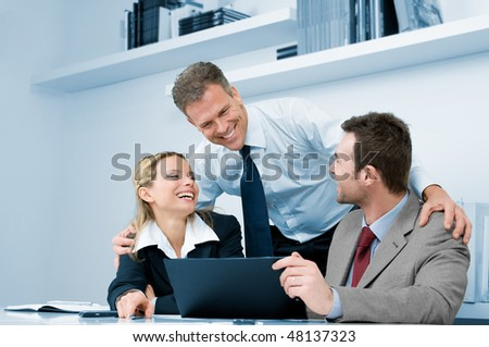 Happy business team working together during a meeting in office with satisfaction - stock photo