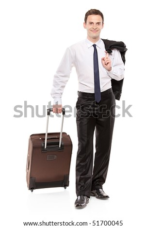 Happy business traveler carrying his luggage isolated on white background - stock photo
