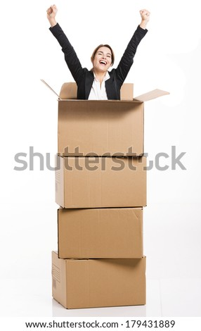 Happy business woman appear inside a big card box, isolated over white background