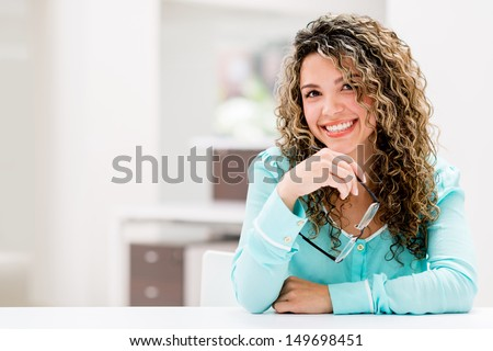 Happy business woman at the office smiling  - stock photo