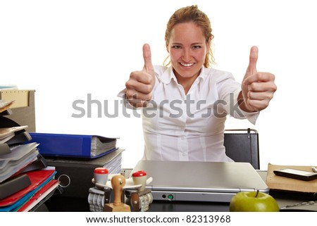 Happy business woman at work holding both thumbs up - stock photo