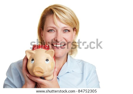 Happy business woman carrying a big piggy bank