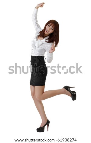 Happy business woman dancing, full length portrait isolated on white. - stock photo