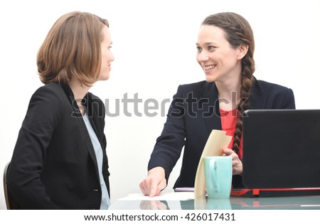 Happy business woman getting instructions from her boss - stock photo