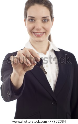 Happy business woman holding a key isolated over white background - stock photo