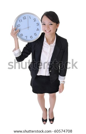 Happy business woman holding clock on shoulder with joy, full length portrait isolated on white background. - stock photo