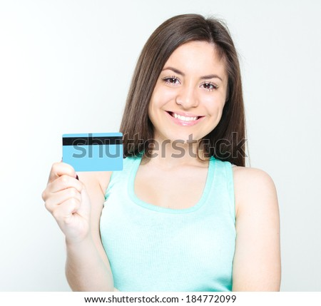 Happy business woman holding credit card
