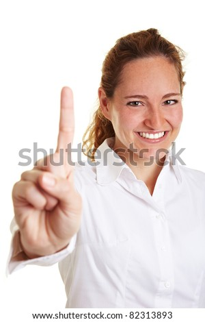 Happy business woman holding her index finger up - stock photo