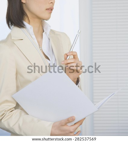 happy business woman holding papers - stock photo