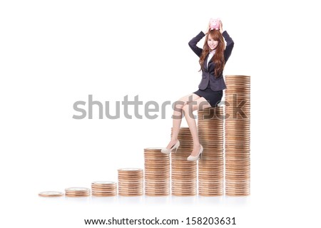 Happy business woman holding pink piggy bank and sitting on money stairs isolated against white background, business concept - stock photo