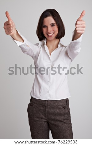 Happy business woman holds two thumbs up - stock photo