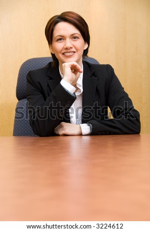 happy business woman in a boardroom table