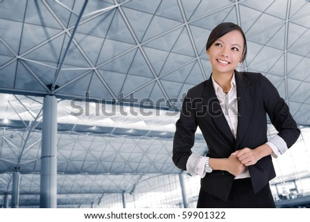 Happy business woman in office with smiling expression. - stock photo