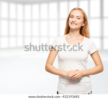 Happy business woman in the office. Young smiling female in empty room - stock photo