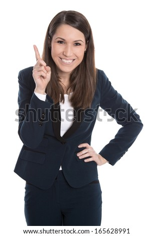 Happy business woman is pointing with forefinger isolated on white. - stock photo