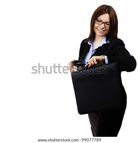 happy business woman looking at her watch on white background - stock photo