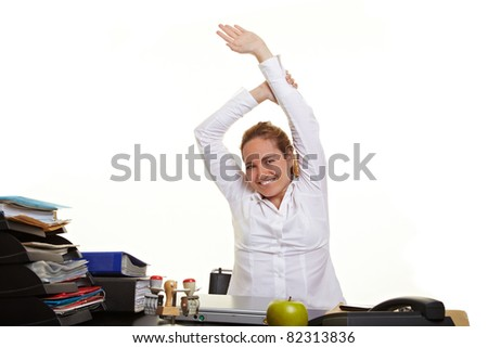 Happy business woman loosen up at her desk at work - stock photo