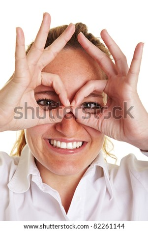 Happy business woman making circles with her fingers around her eyes - stock photo