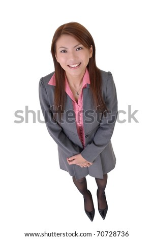 Happy business woman of Asian, full length portrait isolated over white.