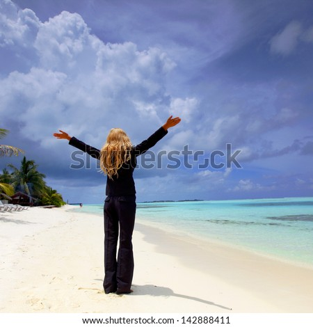 happy  business woman on the desolate ocean coast - stock photo