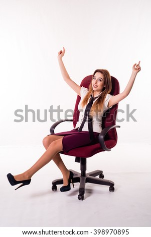Happy business woman scrolls sitting on a chair, his hands holding the top - stock photo
