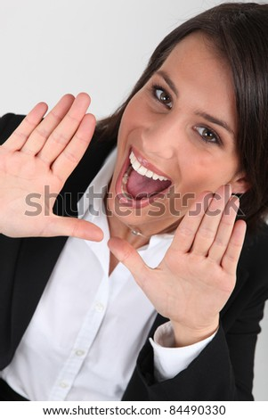 Happy business woman shouting - stock photo