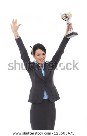 Happy business woman showing her big trophy over white