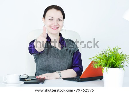 Happy business woman showing thumbs up - stock photo