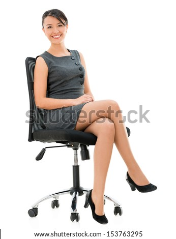 Happy business woman sitting on a chair - isolated over white background - stock photo