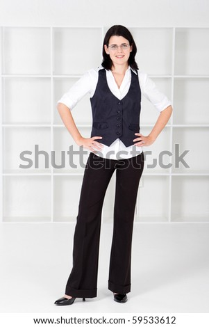 happy business woman standing in office - stock photo