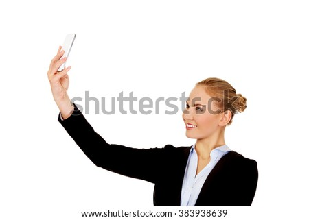 Happy business woman taking selfie photo smartphone - stock photo