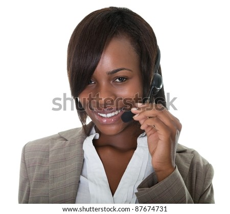 Happy business woman wearing a headset on white background. - stock photo