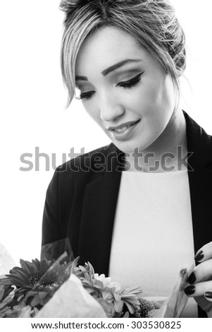 happy business woman with a bunch of flowers