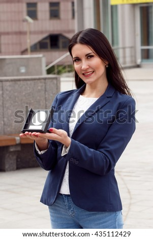 Happy Business woman with award on urban background - stock photo