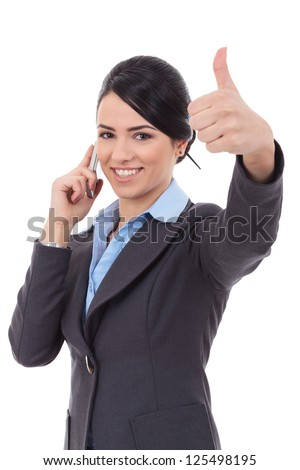 Happy business woman with phone and thumbs up gesture, isolated - stock photo